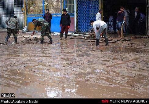 image گزارش تصویری از بارش باران و سیل در بهشر