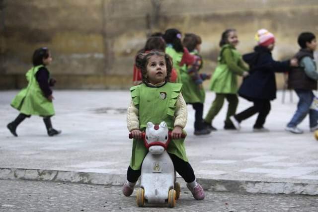image بازی کودکان در یکی از پارک های شهر حلب سوریه